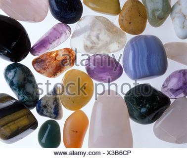 Semi-precious stones, healing stones, worry stones, ponder stones, palm stones, hand charmers - Stock Photo