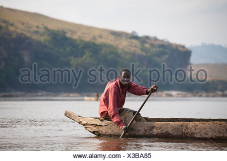 A fisherman in his pirogue on the Congo River at Bulu. - Stock Photo