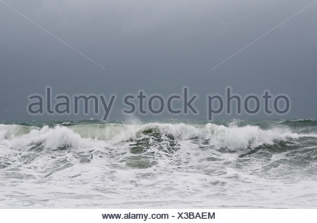 View of rough waves in sea against the sky - Stock Photo