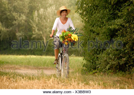 Summer, food, nutrition, land life, health, vegetables, fruits, purchase, vitamins, bicycle, bike, healthy, woman, Switzerland, - Stock Photo