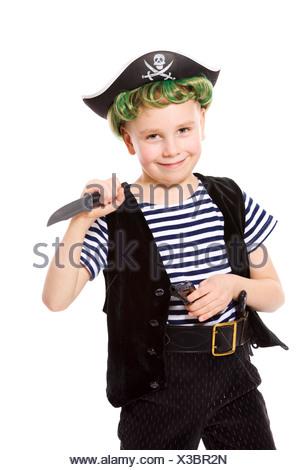 Boy wearing pirate costume holding knife isolated on white - Stock Photo