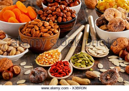 Composition with dried fruits and assorted nuts. - Stock Photo