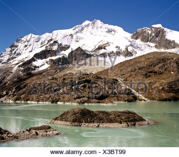 Mt. Huayna Potosi viewed from the reservoir at Zongo Pass, Cordillera Real, La Paz, the Andes, Bolivia - Stock Photo