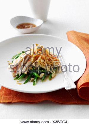 Plate of chicken with noodles and beans - Stock Photo