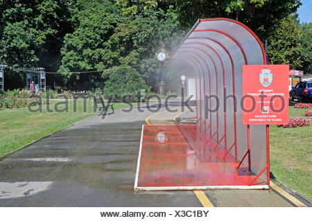 Public water sprinkling system, hot weather, water, cooling, summer, Bucharest, Romania, Eastern Europe, Europe, PublicGround - Stock Photo