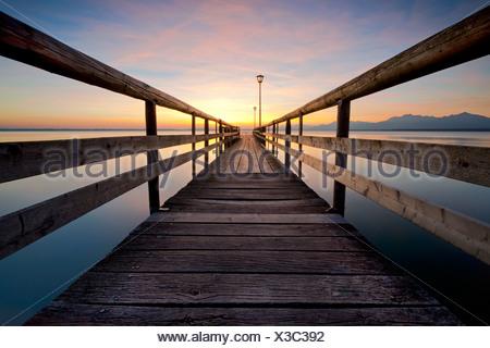 Jetty at sunrise near Chieming on Chiemsee Lake, Bavaria, Germany, Europe, PublicGround - Stock Photo