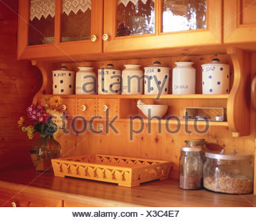 Kitchen unit, rural, detail, wall, wall covering, wooden, wooden walls, setup, rustic, rurally, wooden, country house style, residential style, home decor, inside, interior arrangement, cuisine, fitted kitchen, cupboard, sideboard, fields, spices, spice cases, stock tins, tins, retention, stock, marks, work surface, Still life - Stock Photo