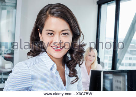 Mature woman in office, portrait - Stock Photo