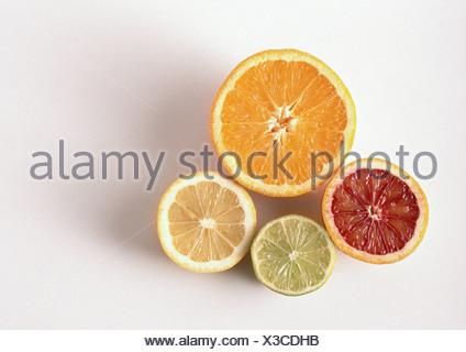 Cross sections of orange, blood orange, lemon, lime, close-up, high angle view, white background - Stock Photo