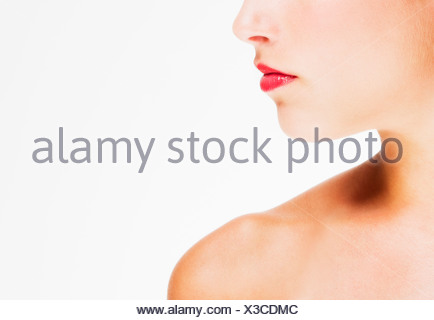 Studio shot of young woman wearing red lipstick - Stock Photo