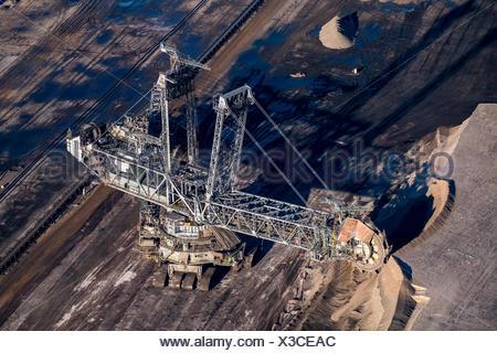 Bucket excavator removing overburden, brown coal mine Garzweiler, Grevenbroich, North Rhine-Westphalia, Germany - Stock Photo