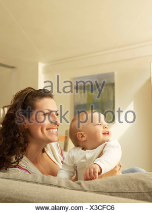 Mother holding baby,  side view - Stock Photo