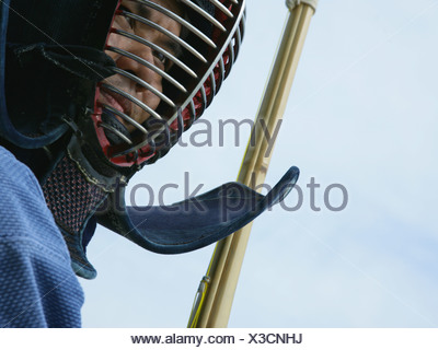 Close-up of a man wearing a fencing mask - Stock Photo