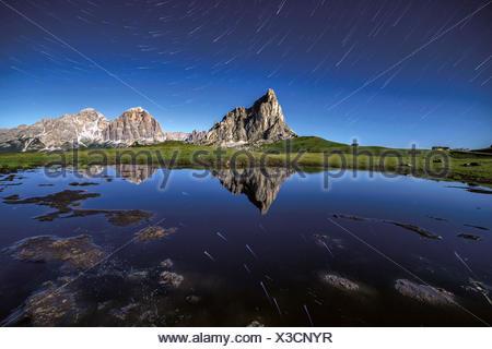 Startrail at Giau Pass during a full moon summer night, Cortina d'Ampezzo, Dolomites, Veneto, Italy, Europe - Stock Photo