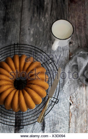 Soft and delicious bundt cake with a golden velvety crumb. - Stock Photo
