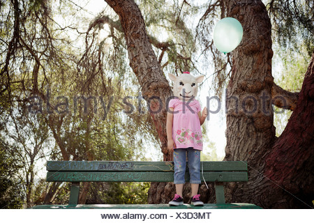 Child in costume of sheep head mask - Stock Photo
