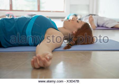 young woman relaxing in yoga class - Stock Photo