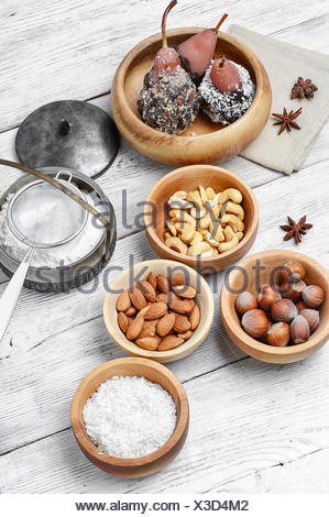 Pears in chocolate-coconut syrup and nuts with almonds - Stock Photo