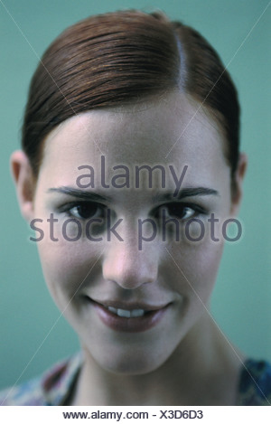 Woman smiling at camera, portrait - Stock Photo