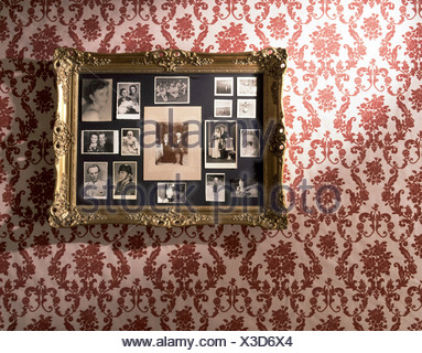 Picture Frames With Different Photos On The Wall Stock Photo