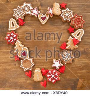 Bunte Plaetzchen in Herzform zu Weihnachten - Stock Photo