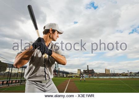 Baseball batter concentrating - Stock Photo