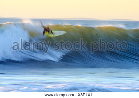 Motion blur of a surfer at dusk at Pitas Point in Ventura, California. - Stock Photo