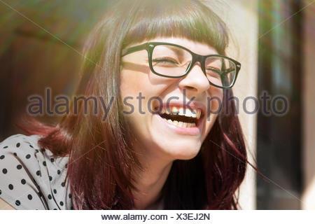 Young woman laughing with joy, Osijek, Croatia - Stock Photo
