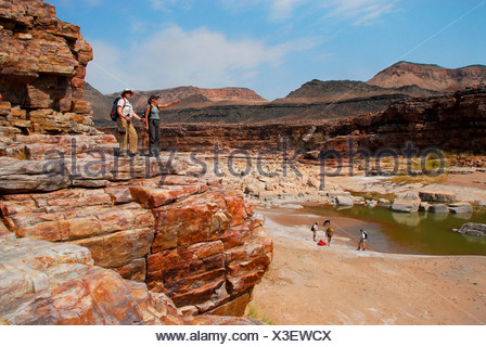 Hikers in the Fish River Canyon, Namibia, Africa - Stock Photo
