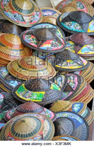 Hats, Floating Market in Damnoen Saduak, southwest of Bangkok, Thailand, Asia - Stock Photo