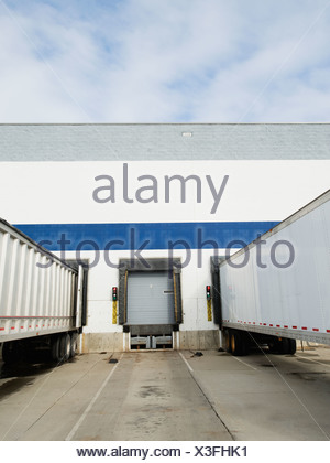 Trucks parked at loading dock - Stock Photo
