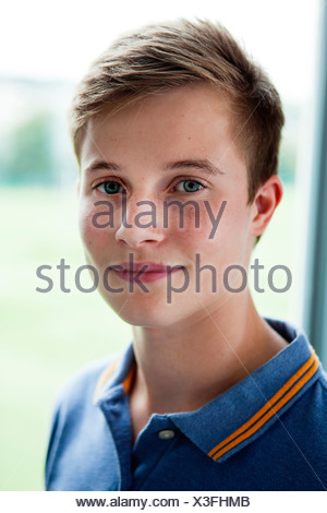 Close up portrait of teenage schoolboy - Stock Photo