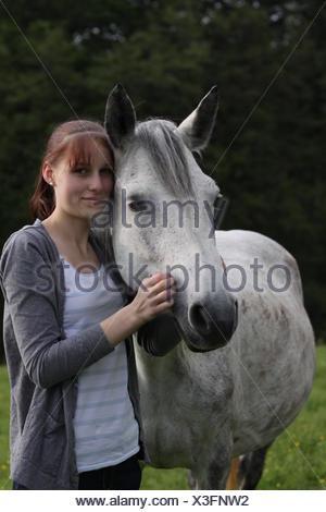 Girl with a Connemara Pony - Stock Photo
