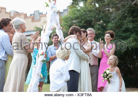 Guests watching bride and groom - Stock Photo