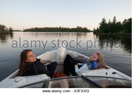 Mother and daughter on a boat, Lake of the Woods, Ontario, Canada - Stock Photo