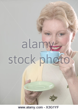 Woman with teacup and saucer - Stock Photo