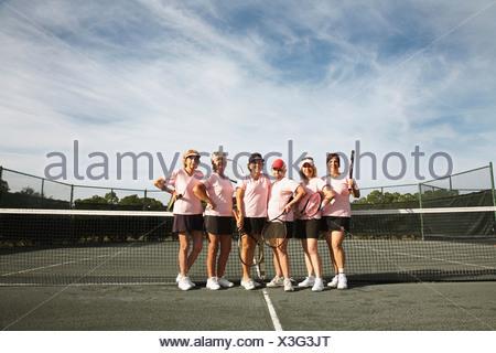 Women playing tennis in Ft. Pierce, Florida. - Stock Photo