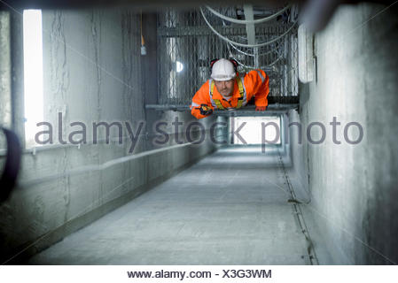 Engineer inspecting tower shaft in suspension bridge Humber Bridge UK was built in 1981 - Stock Photo