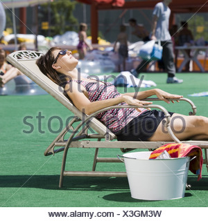 woman sunbathing - Stock Photo