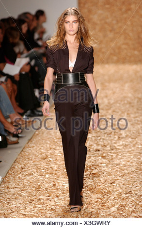 Anne Klein Ready to Wear New York spring summer fashion show Model long fair hair plaits wearing black catsuit sparkly detail - Stock Photo