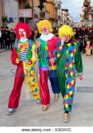 Three men dressed up as clowns, carnival on Shrove Tuesday, Balestrate, Sicily, Italy, Southern Europe - Stock Photo