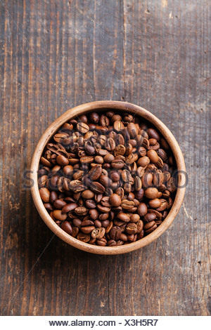 Coffee beans in ceramic bowl - Stock Photo
