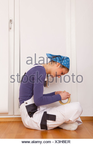 Young woman teenager Decorating new home moving - Stock Photo