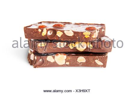 Stack of three chocolate bars isolated on white background. - Stock Photo