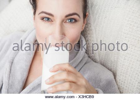 Mature drinking a glass of milk - Stock Photo