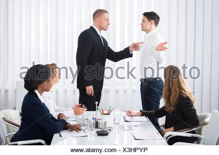 Businessman Blaming His Colleague In Meeting - Stock Photo