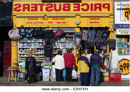 Cheap shops on Dumbarton Road Partick West End of Glasgow poor area with high unemployment Scotland - Stock Photo