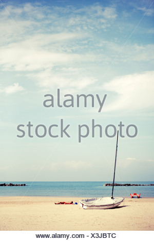 Calm beach with boat - Stock Photo