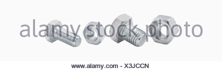 Bolts and nuts against white background, close up - Stock Photo