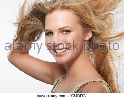 Portrait of young blonde woman - Stock Photo